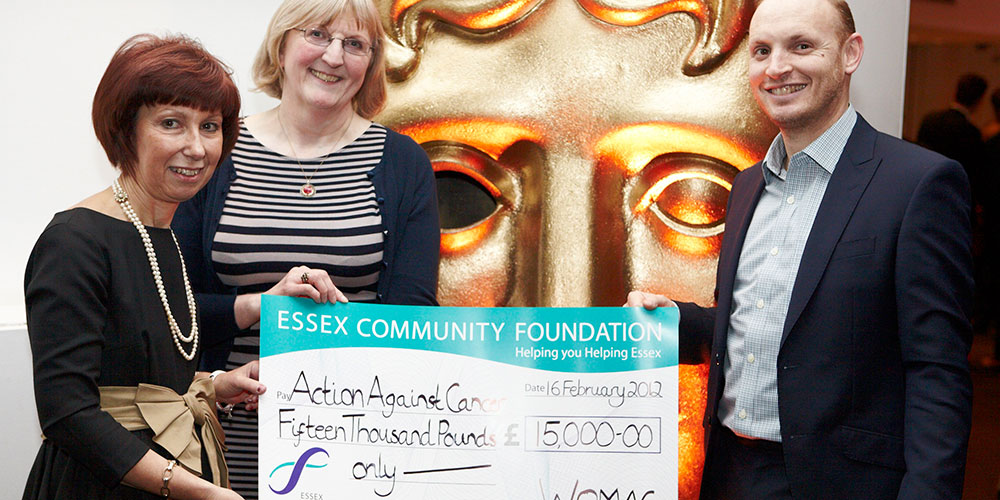 Hilary Craft, another lady and Professor Stebbing holding giant cheque